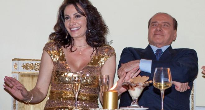 Мадам Мулти с любовно обяснение към Берлускони
